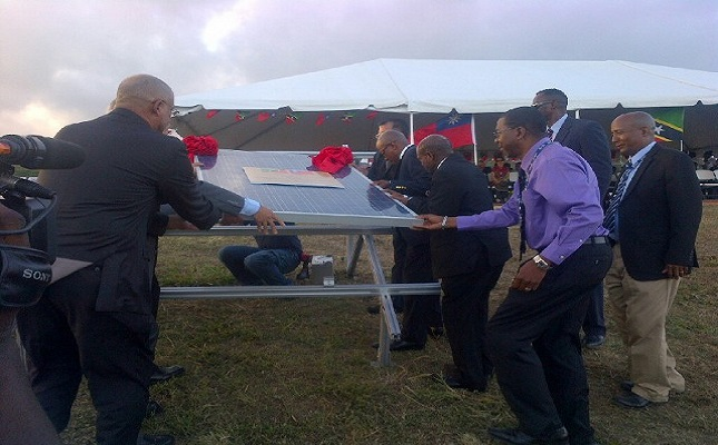 Officials symbolically laying the first panel for the Solar Farm at the Robert L. Bradshaw International Airport (Photos by Erasmus Williams)
